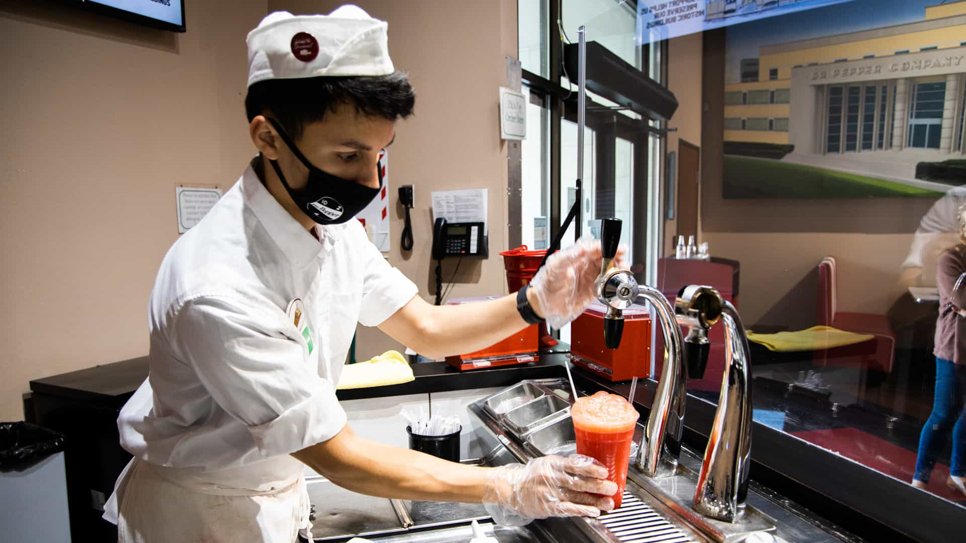 soda jerk making a big red float